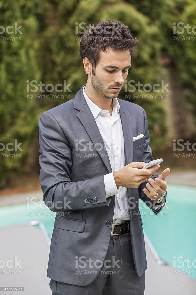 Young Businessman  with Mobile Phone royalty-free stock photo