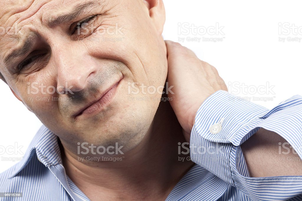Young businessman with neck pain royalty-free stock photo