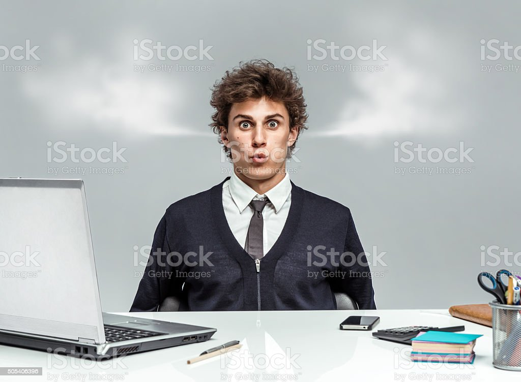 Young businessman with steam from his ears stock photo
