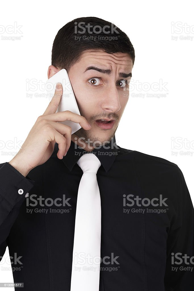Young Businessman with Surprised Expression on the Phone stock photo