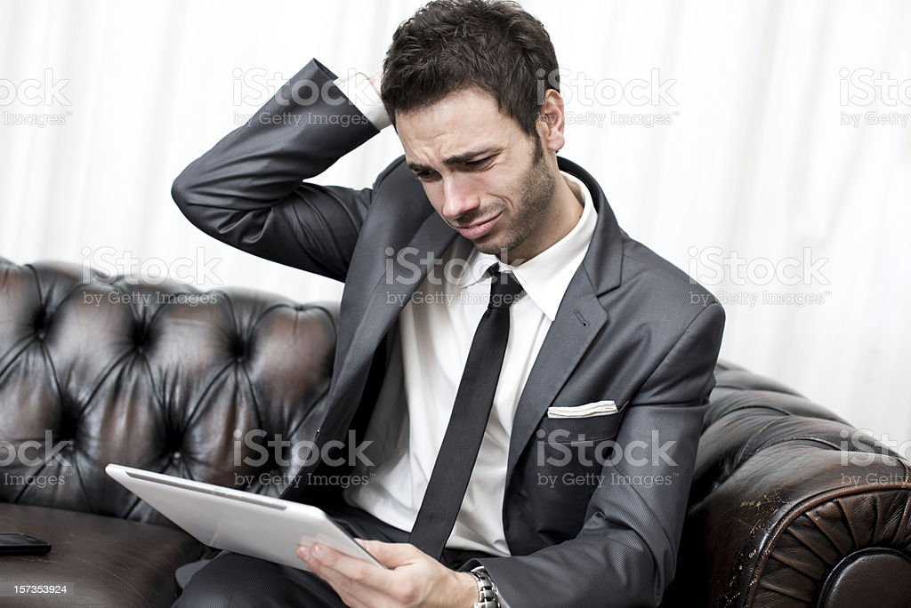 Young businessman with tablet and smart phone royalty-free stock photo