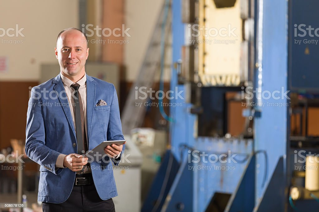 Young Businessman with Tablet stock photo