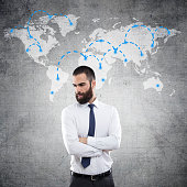 Young businessman with world map