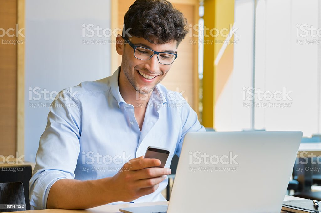 Young businessman working at caf?? stock photo