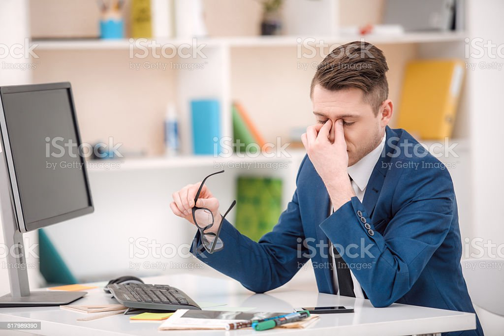 Young businessman working in office stock photo