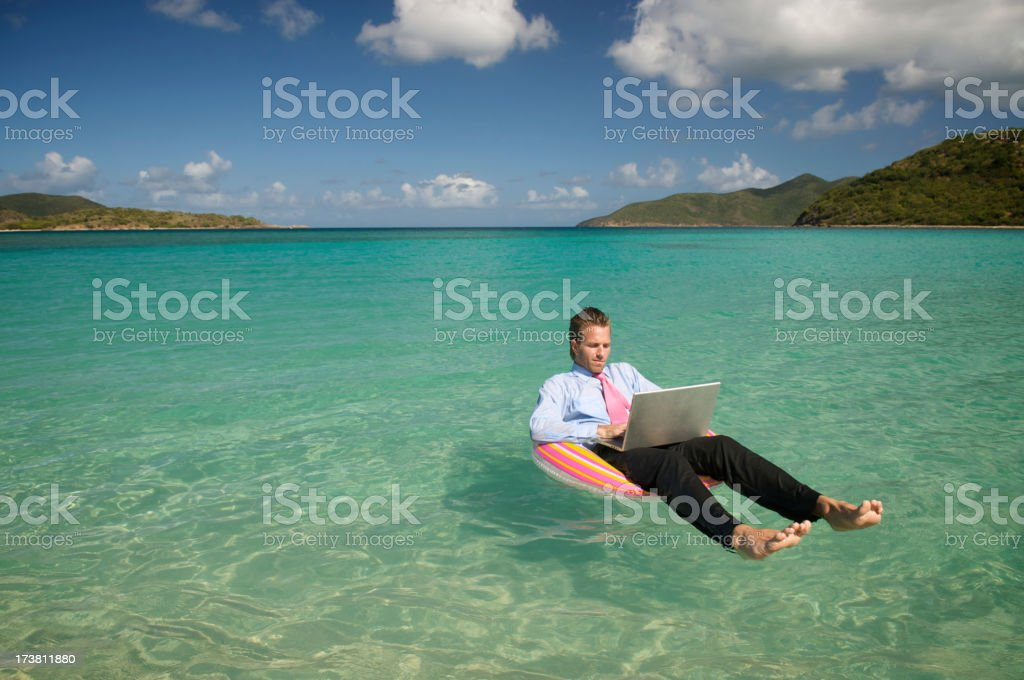 Young Businessman Working Island Style Relaxing in Sea stock photo