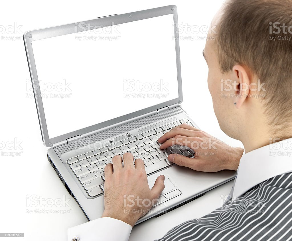 young businessman working of a laptop royalty-free stock photo