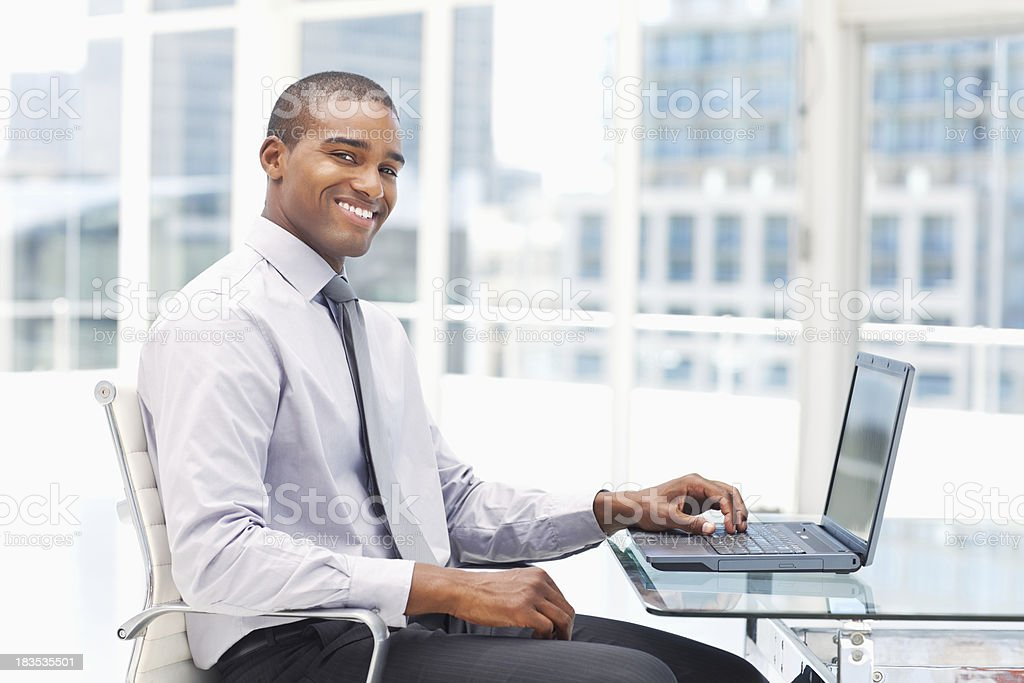 Young Businessman Working on a Laptop royalty-free stock photo