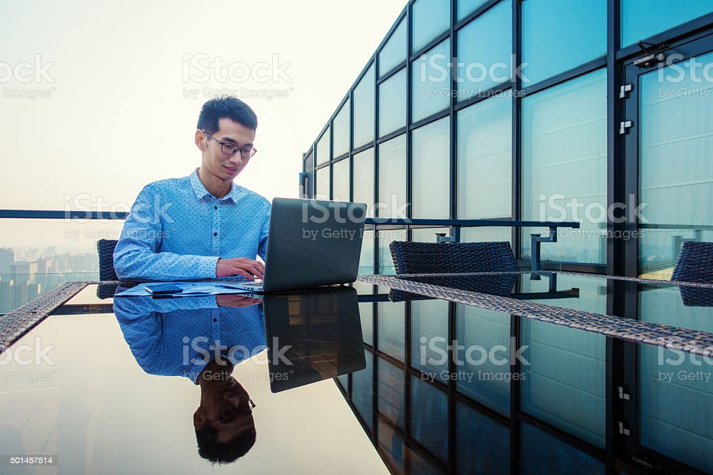 Young businessman working on a laptop stock photo