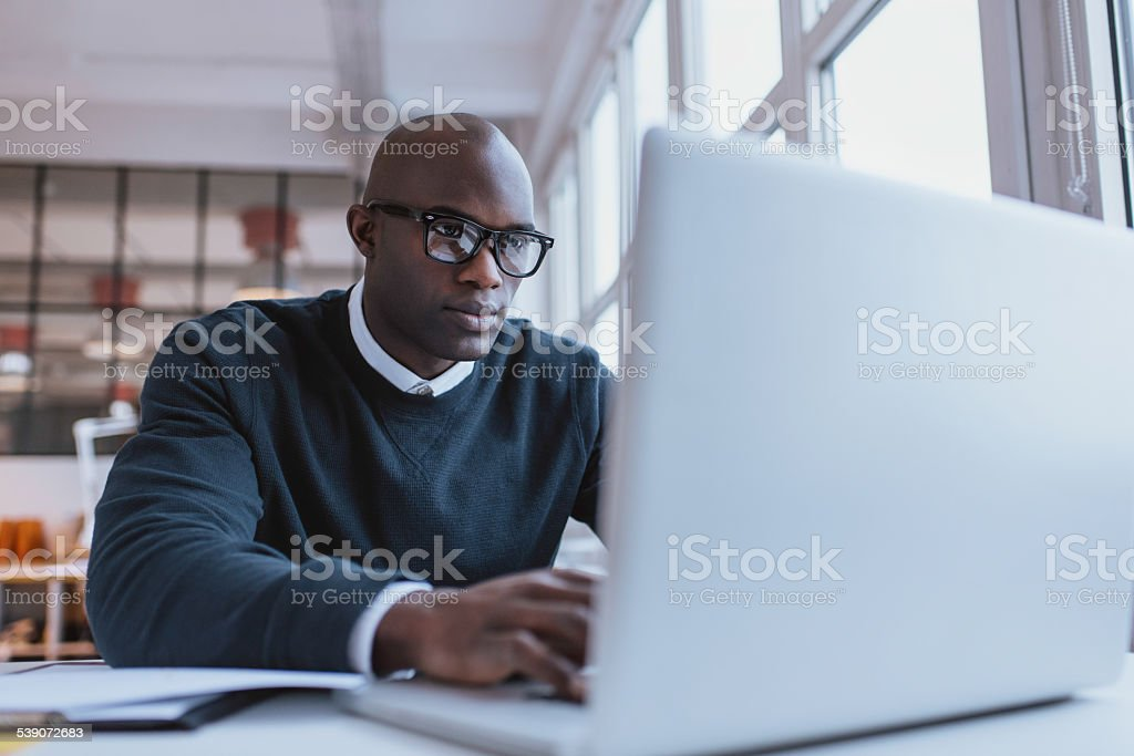 Young businessman working on his laptop stock photo