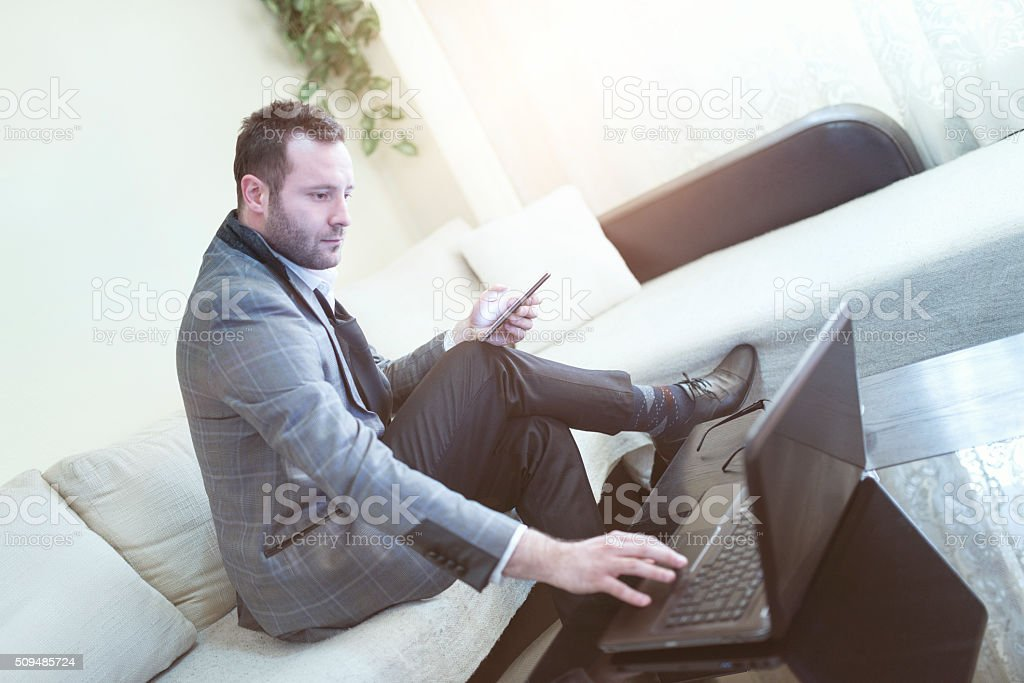 Young Businessman Working on Laptop at Home stock photo