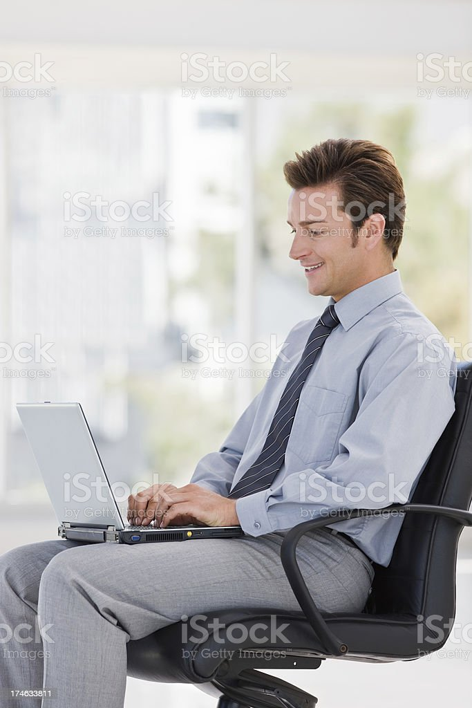 Young businessman working on laptop royalty-free stock photo