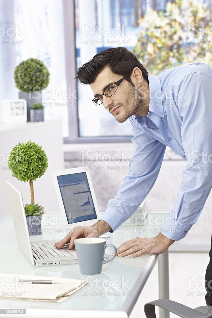 Young businessman working with laptop computer royalty-free stock photo