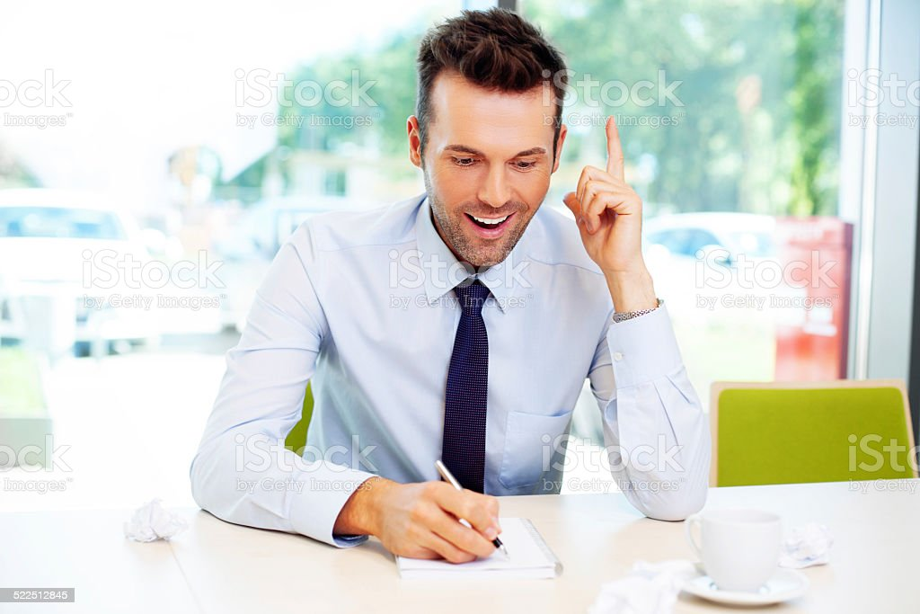 Young businessman write in notebook his new idea stock photo
