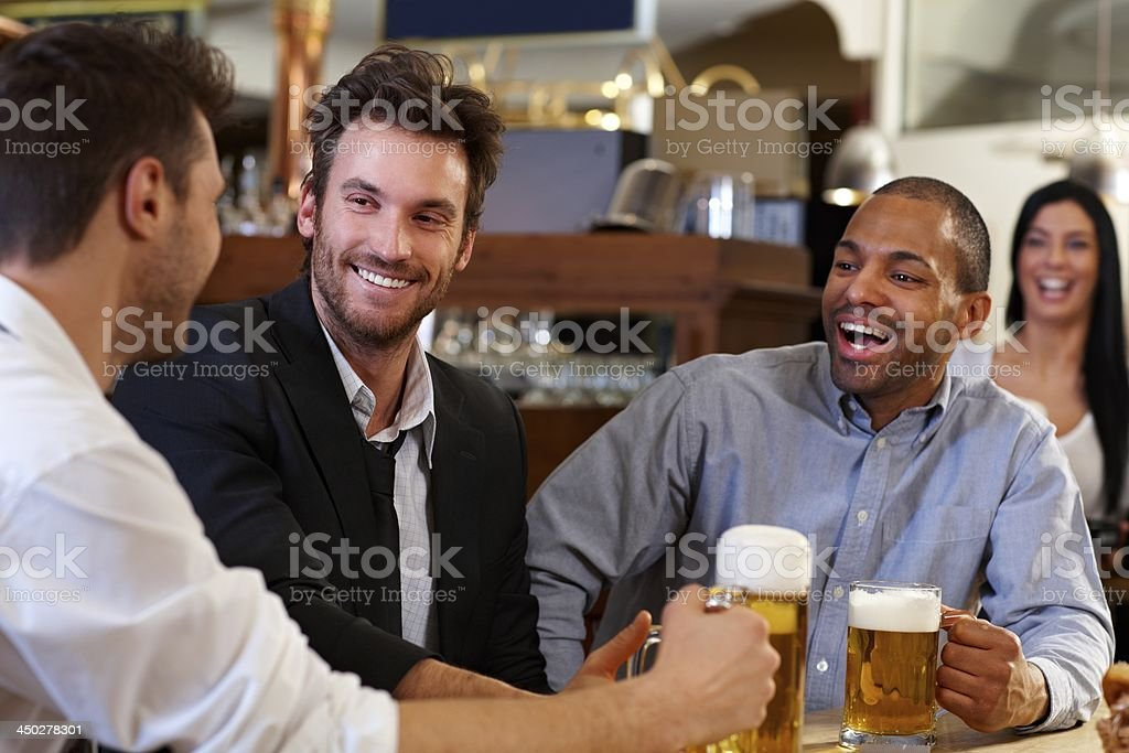 Young businessmen drinking beer at pub stock photo