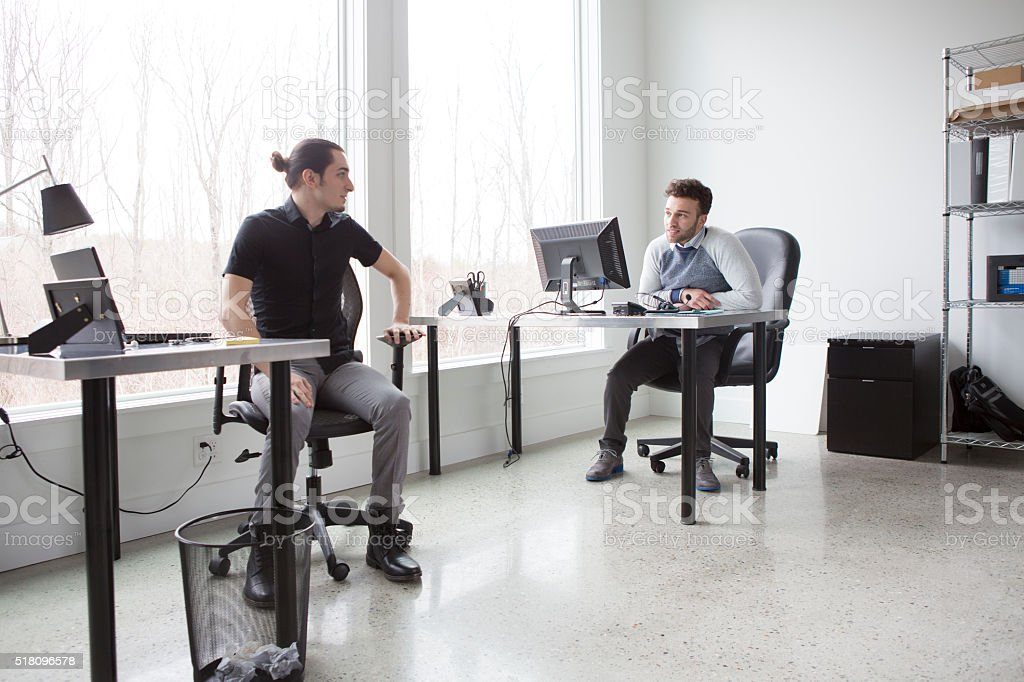 Young Businessmen in an Office stock photo