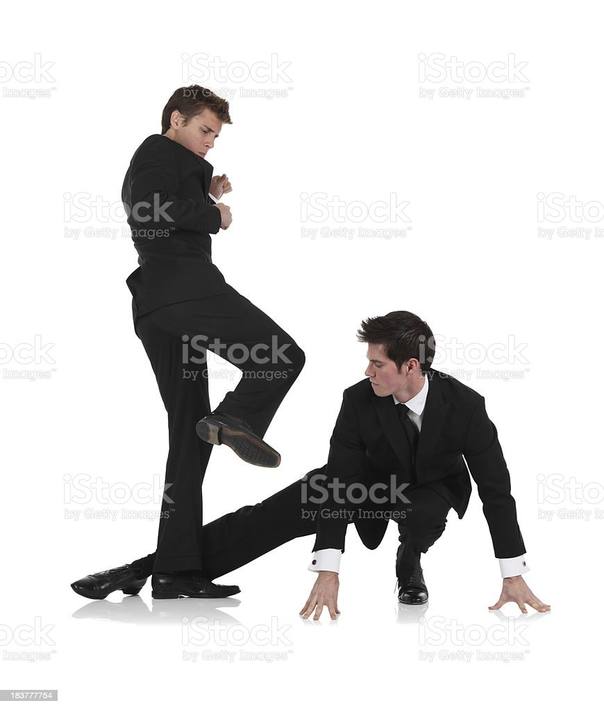 Young businessmen karate fighting royalty-free stock photo