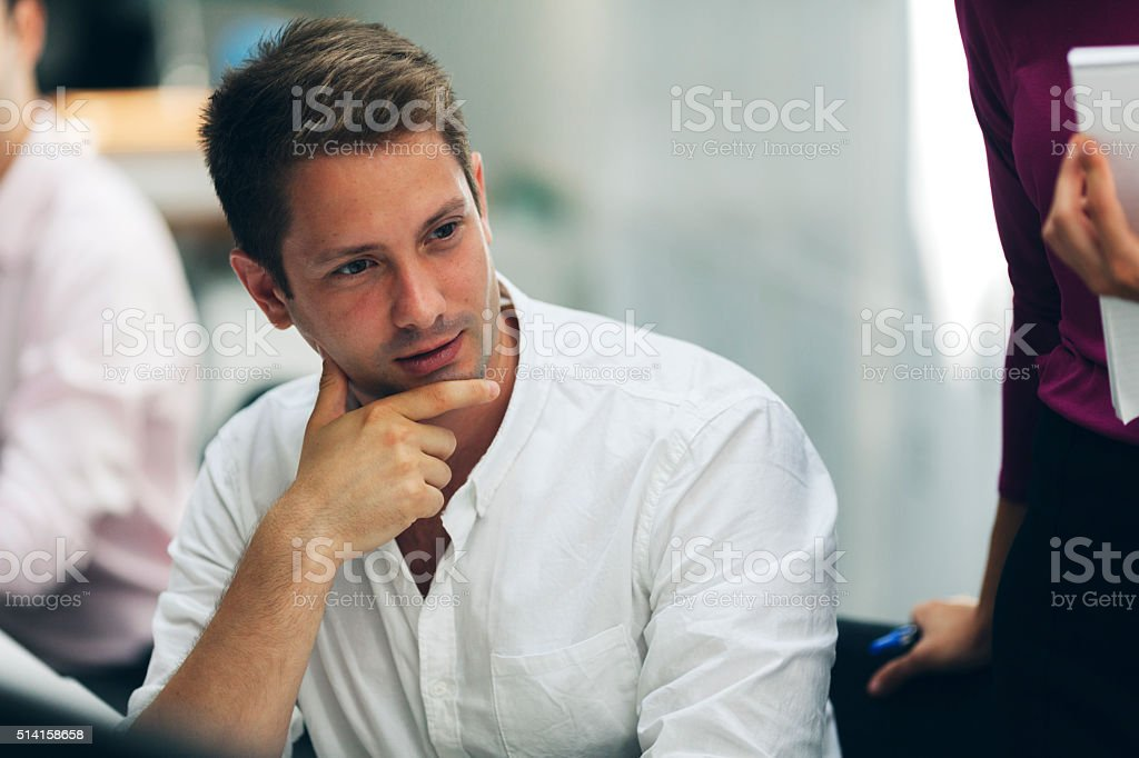 Young Businessmen Working At His Office. stock photo