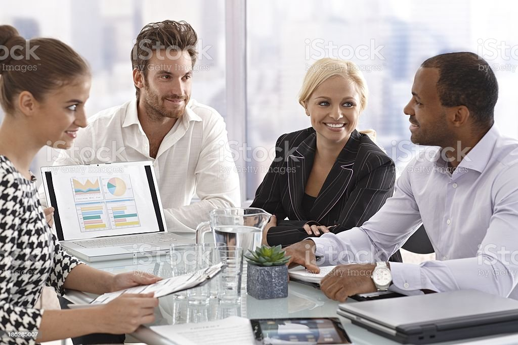 Young businesspeople at a meeting stock photo