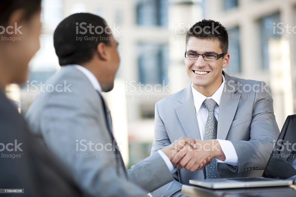 Young businesspeople making a business deal. royalty-free stock photo