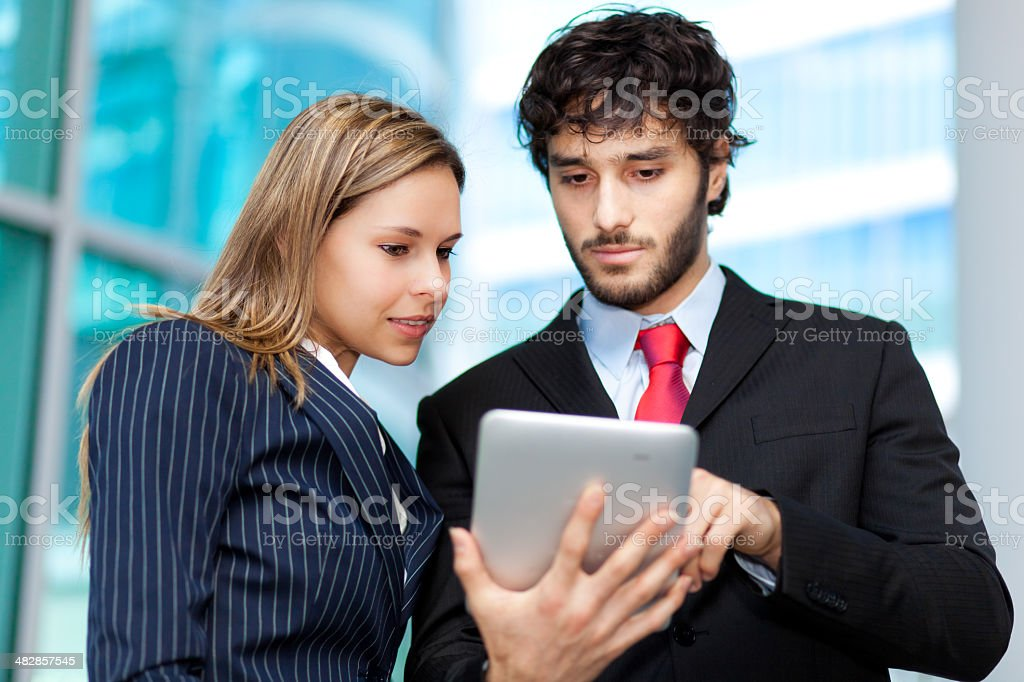 Young businesspeople using a tablet royalty-free stock photo