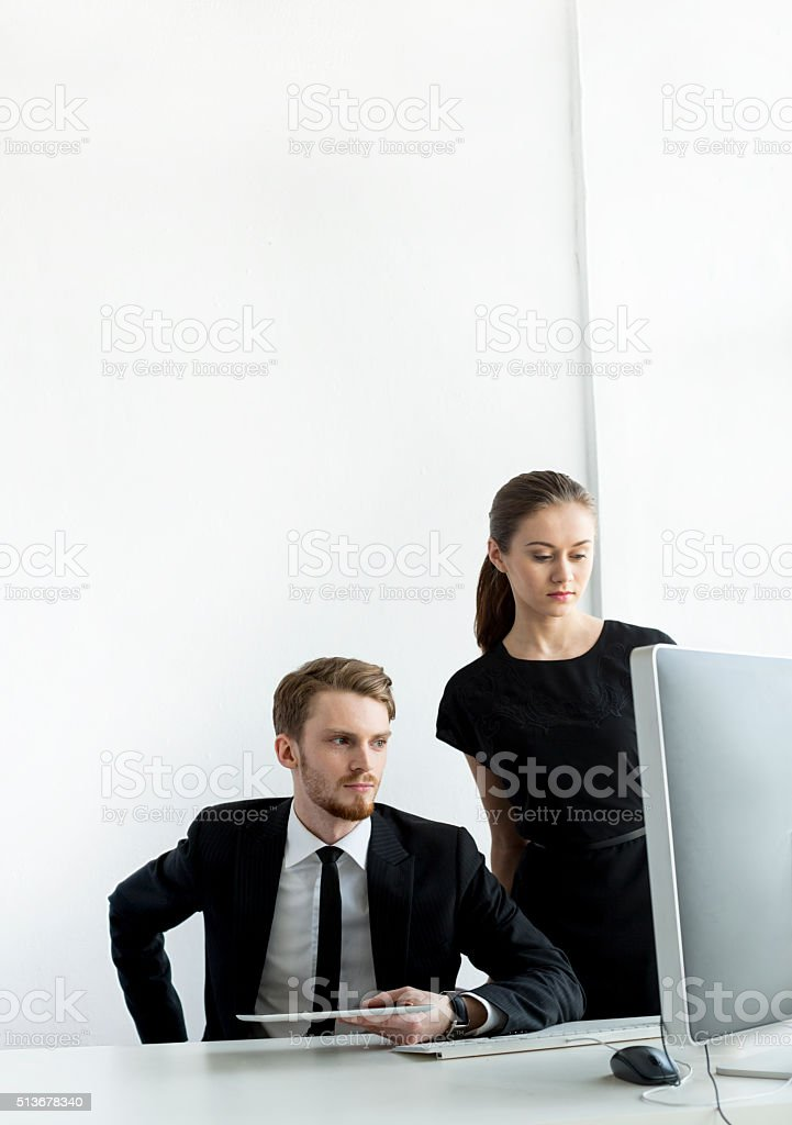 Young Businesspeople Using Tablet And Computer In The Office stock photo