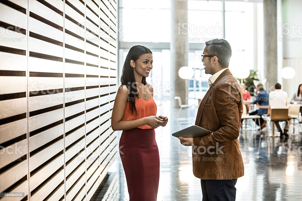 Young businesswoman and male colleague in modern office. stock photo