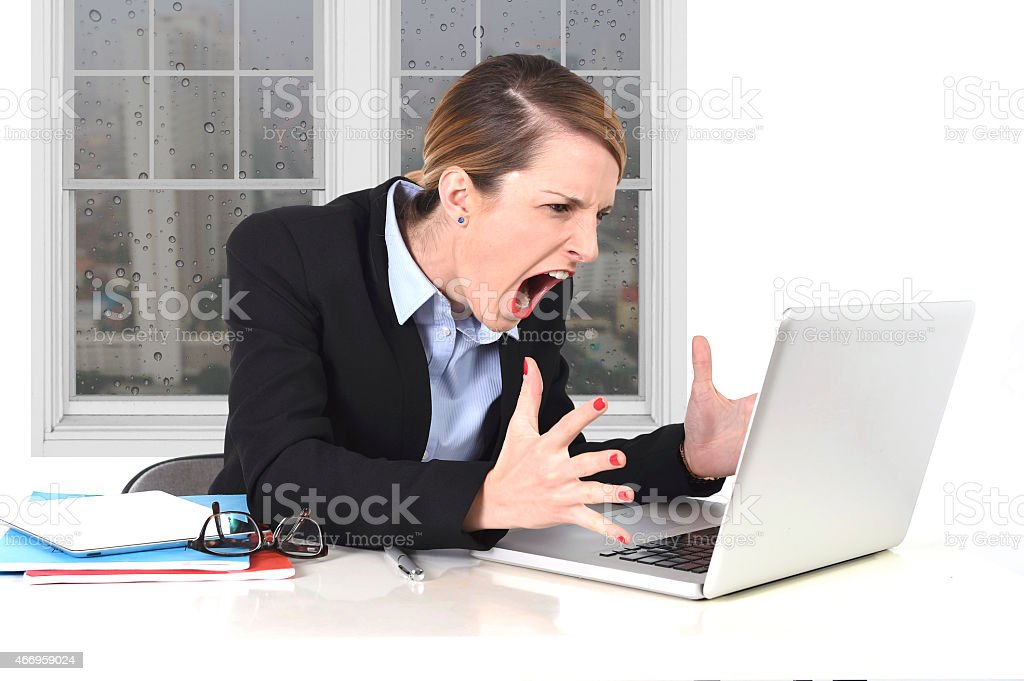 young businesswoman angry in stress at office working on computer stock photo
