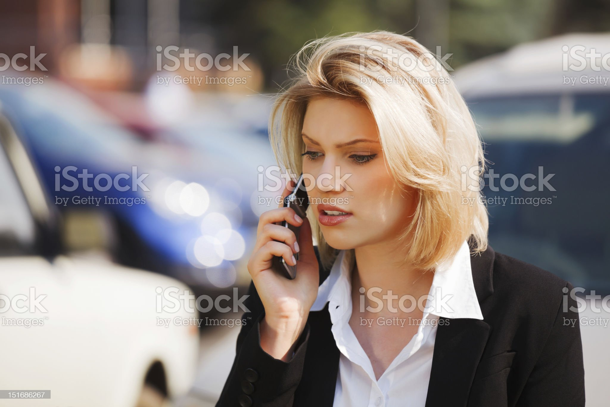 Young businesswoman calling on the mobile phone royalty-free stock photo