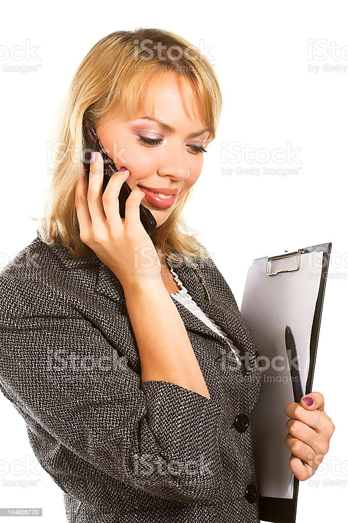 Young businesswoman calls on mobile royalty-free stock photo