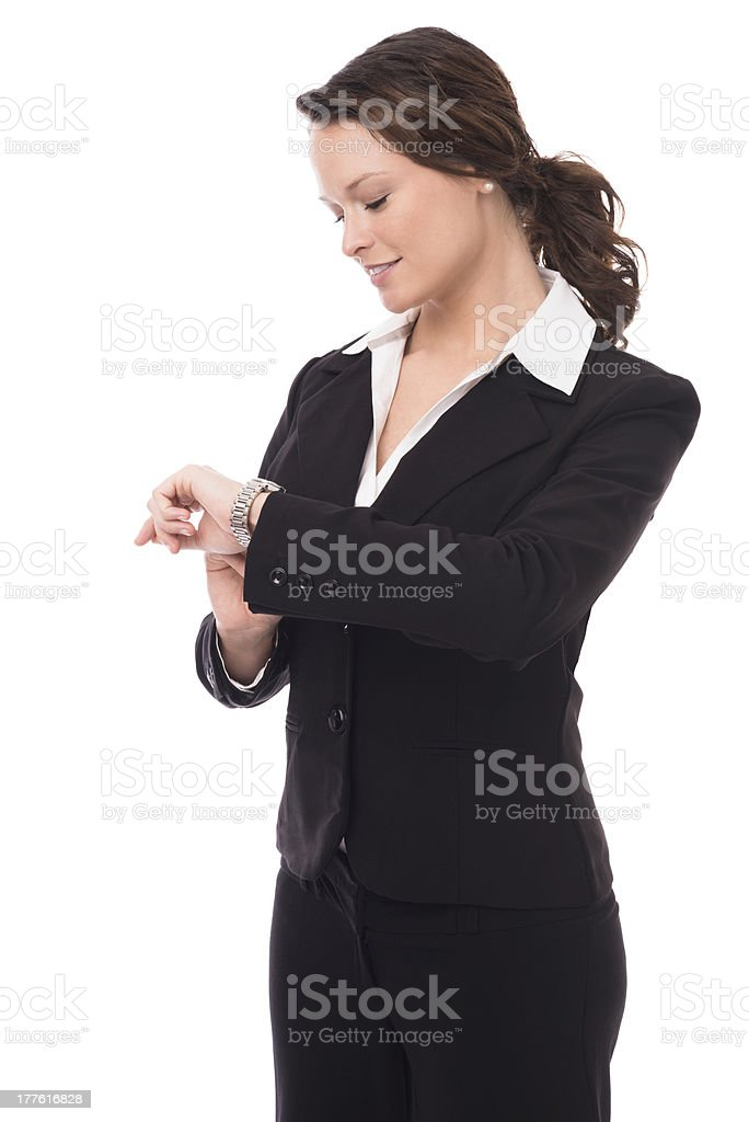 Young Businesswoman Checking Wristwatch on White stock photo