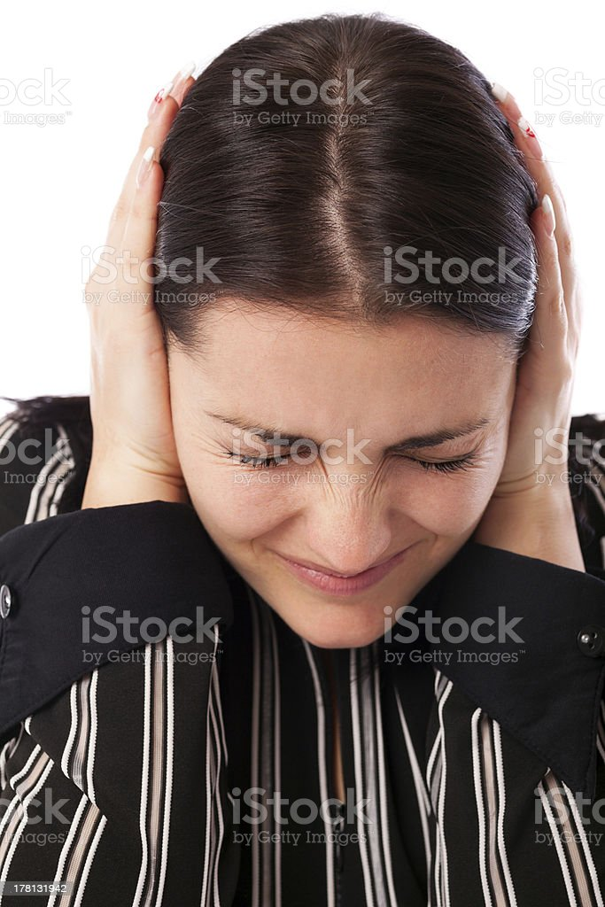 Young businesswoman covering ears with her hands royalty-free stock photo