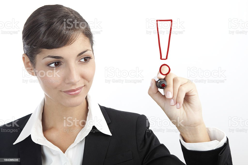 Young Businesswoman drawing an exclamation mark royalty-free stock photo