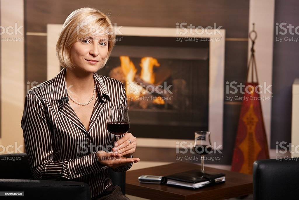 Young businesswoman drinking red wine royalty-free stock photo