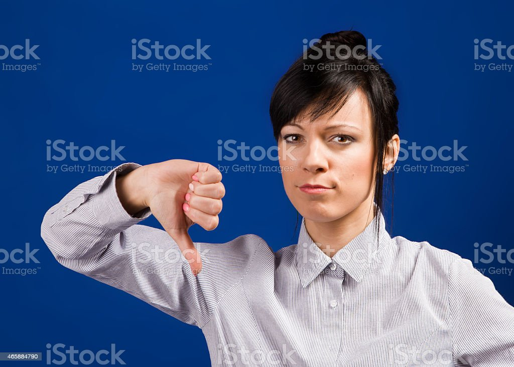Young businesswoman gives negative sign stock photo