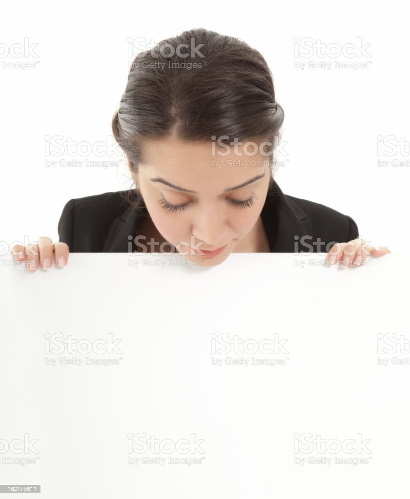 Young businesswoman holding a billboard royalty-free stock photo