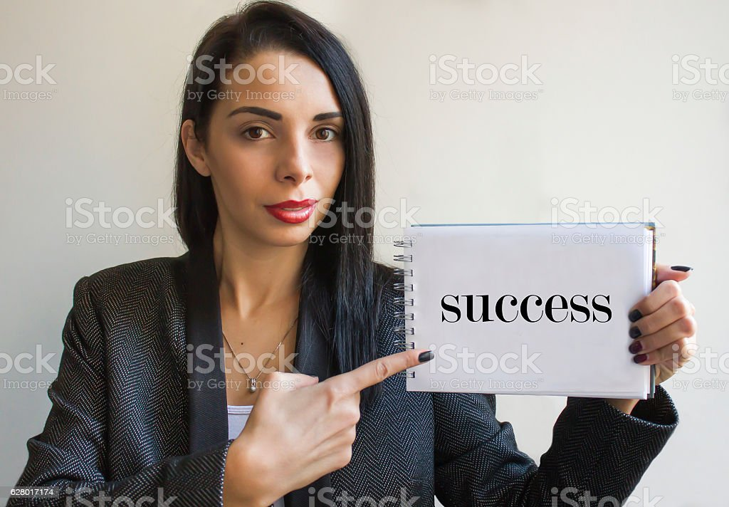 Young businesswoman holding a cardboard sign, success stock photo