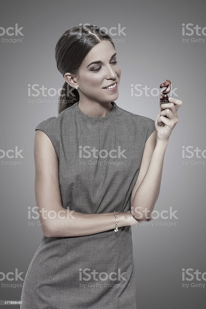 Young businesswoman holding dark knight royalty-free stock photo
