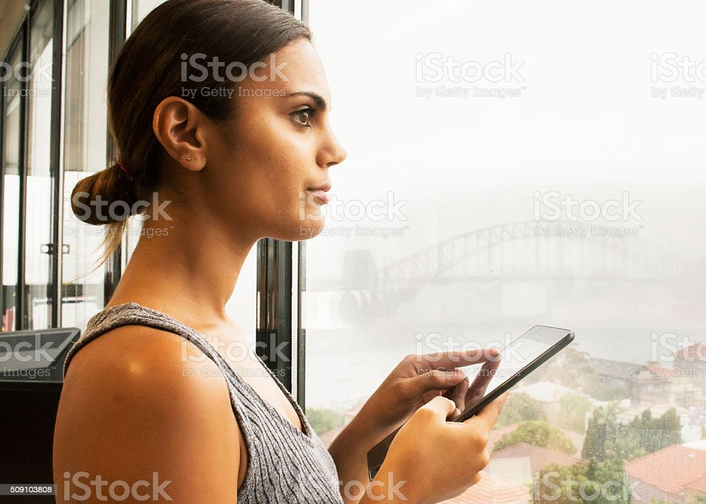 Young businesswoman holding digital tablet. stock photo