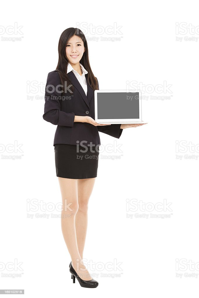 young businesswoman holding laptop royalty-free stock photo