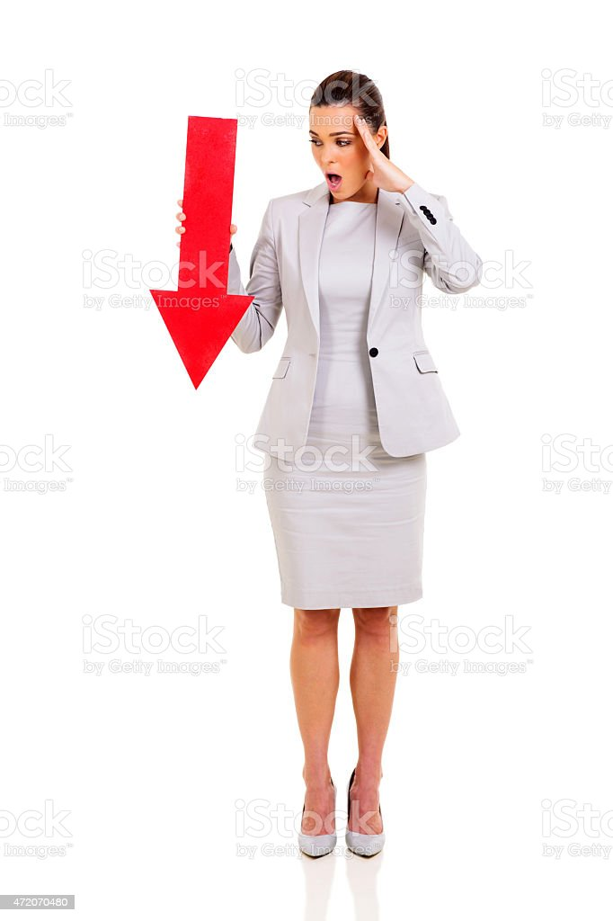 young businesswoman holding red arrow stock photo