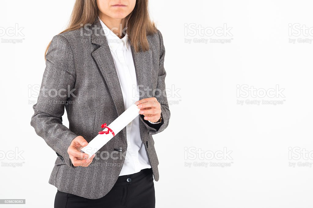 Young Businesswoman holds up her certificate stock photo