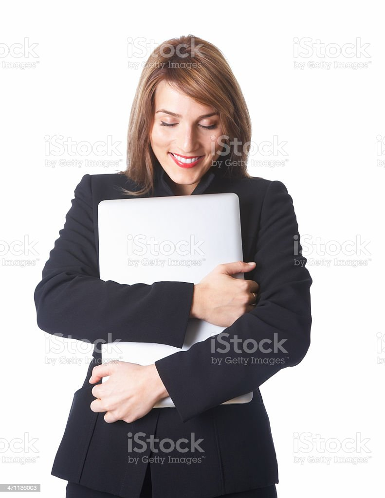 Young businesswoman hugging laptop eyes closed royalty-free stock photo