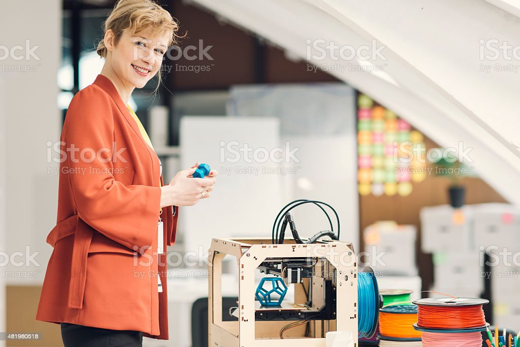 Young Businesswoman in 3D Printing Office. stock photo
