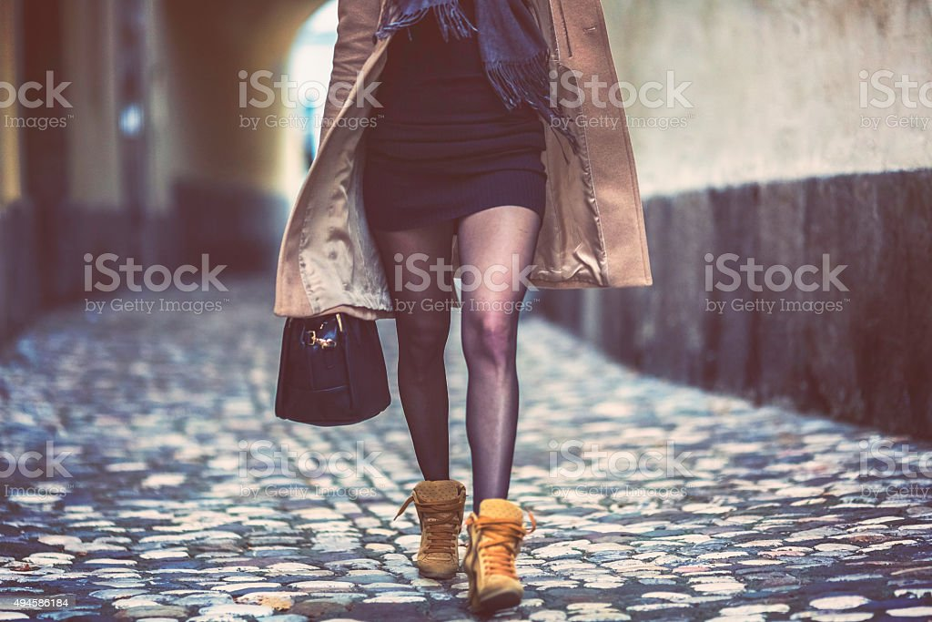 Young businesswoman in a hurry, walking, on the phone stock photo