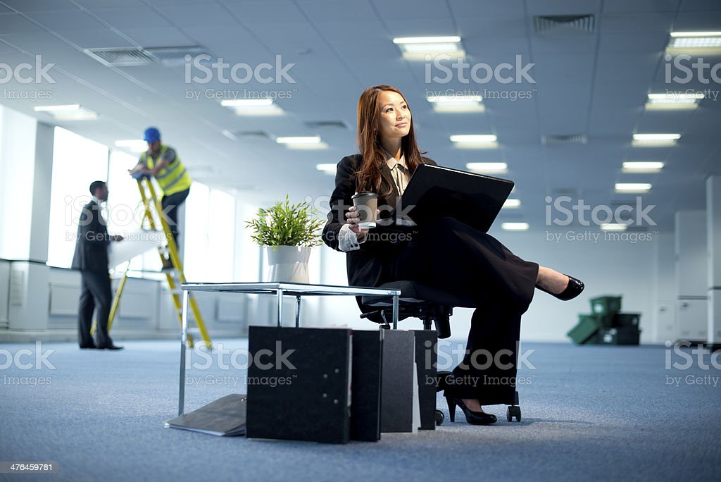 young businesswoman in empty office royalty-free stock photo