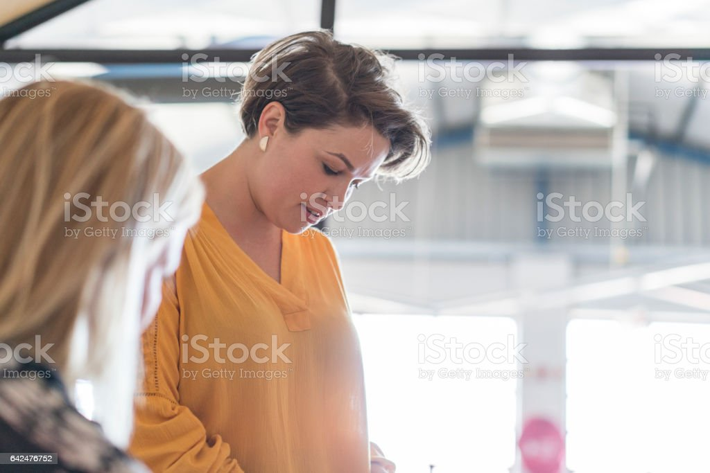 Young businesswoman in meeting room stock photo