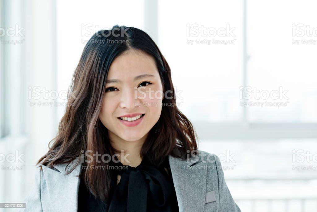 Young businesswoman in modern office stock photo