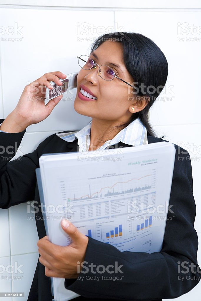 Young businesswoman in on the phone royalty-free stock photo