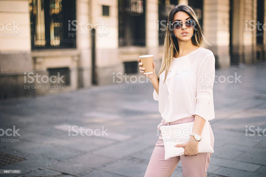 Young businesswoman in the city having a coffee break0 stock photo
